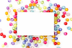 Empty white paper on colorful beads Stock Photos