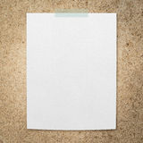 Empty white paper on grunge notice board Stock Photos