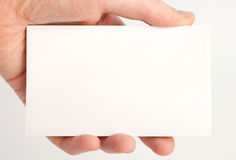Empty white paper in hand. Isolated on white background stock images