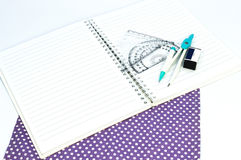 Empty white paper notebook with ruler, protractor, angle, triangle, square on the white background. Royalty Free Stock Photography