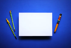 Empty white paper sheet blue background Stock Photography