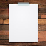 Empty white paper sheet stick on wood background. Stock Image
