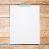 Empty white paper sheet stick on wood background. Royalty Free Stock Photo