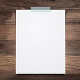 Empty white paper sheet stick on wood background. Stock Photography