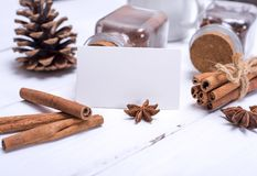 Empty white paper tag and cinnamon sticks Stock Photography