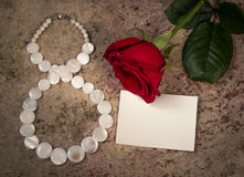 Empty white paper for text, red rose and March 8 Royalty Free Stock Photo