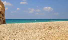 Empty white pebbly beach. Cyprus Beach with White Stones and Blue green Water Stock Photography