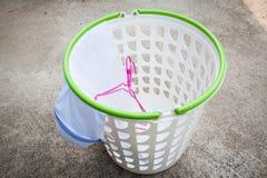 Empty white plastic laundry basket Stock Photos