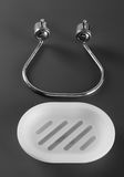 Empty white plastic soap-dish with metal holder Stock Images