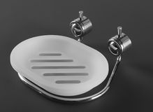 Empty white plastic soap-dish with metal holder Stock Photos