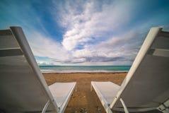 Plastic sunbeds on Tsilivi beach in Zante Island royalty free stock photography