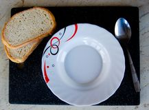 Empty white plate with bread Royalty Free Stock Photos