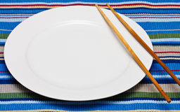 Empty White Plate with Chopsticks Royalty Free Stock Image