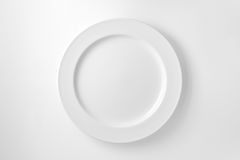 Empty white plate Royalty Free Stock Photos