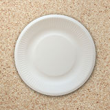 Empty white plate on cork board Stock Photos