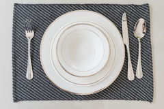 Empty white plate, dinner setting Stock Images