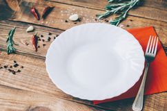 Empty White Plate. On the home wooden kitchen table Stock Photo