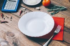 Empty White Plate. On the home wooden kitchen table Stock Photography
