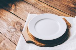 Empty White Plate. On home wooden table Stock Photos