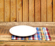Empty white plate with fork and knife Stock Photos