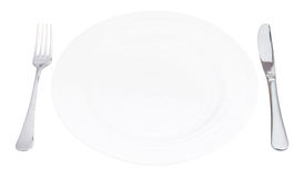 Empty white plate with fork and knife isolated Stock Photos