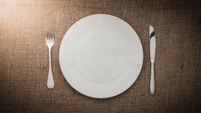 Empty white plate and  fork, knife Royalty Free Stock Image