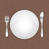 Empty white plate, fork and knife Royalty Free Stock Image