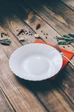 Empty White Plate. On the home wooden kitchen table Stock Image