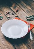 Empty White Plate. On the home wooden kitchen table Stock Images