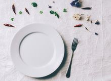 Empty White Plate. On home wooden table Royalty Free Stock Image