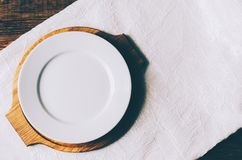 Empty White Plate. On home wooden table Stock Image