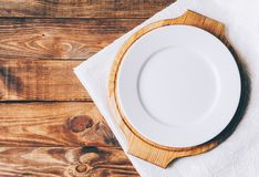 Empty White Plate. On home wooden table Stock Photo