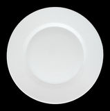 Empty white plate isolated on black background. Royalty Free Stock Photos