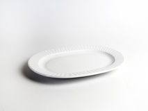Empty white plate. Isolated on white background Royalty Free Stock Images