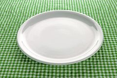 Empty plate on kitchen table Stock Photo