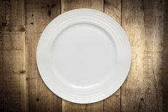 Empty White Plate over Rustic Timber Royalty Free Stock Images