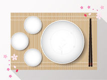 Empty white plate set with chopsticks on a bamboo cover. Vector vector illustration
