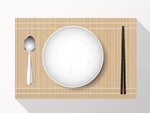 Empty white plate set with chopsticks on a bamboo cover. Vector Stock Images
