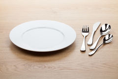 Empty white plate with silverware Stock Photo