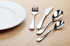 Empty white plate with silverware Stock Photos