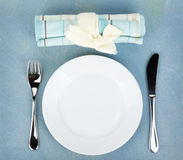 Empty white plate with silverware on wooden table Royalty Free Stock Image