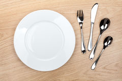 Empty white plate with silverware Stock Images