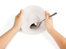 Empty white plate with a spoon Stock Photography