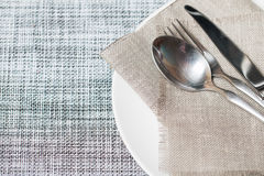 Empty white plate spoon, fork, knife Stock Images