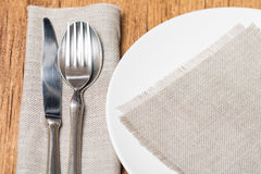 Empty white plate spoon, fork, knife Stock Photography