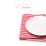 Empty white plate on tablecloth. On white background Royalty Free Stock Photo