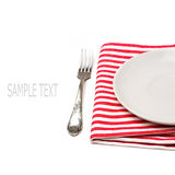 Empty white plate on tablecloth with fork. On white background Royalty Free Stock Images