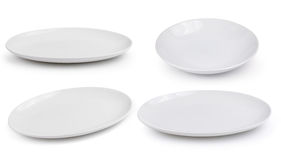 Empty white plate on white background Royalty Free Stock Image