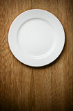 Empty White Plate on Wood royalty free stock photography