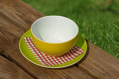 Empty white plate on wooden table Royalty Free Stock Photography